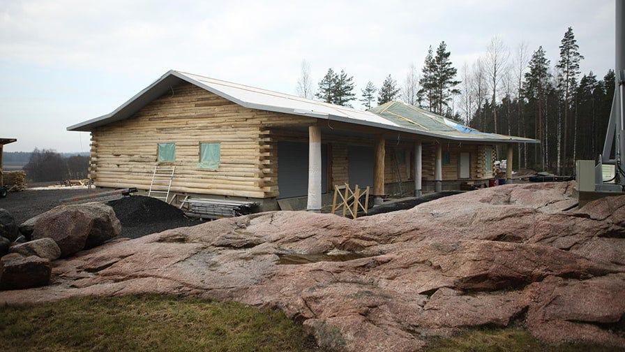 An aspen octagonal timber house back side view