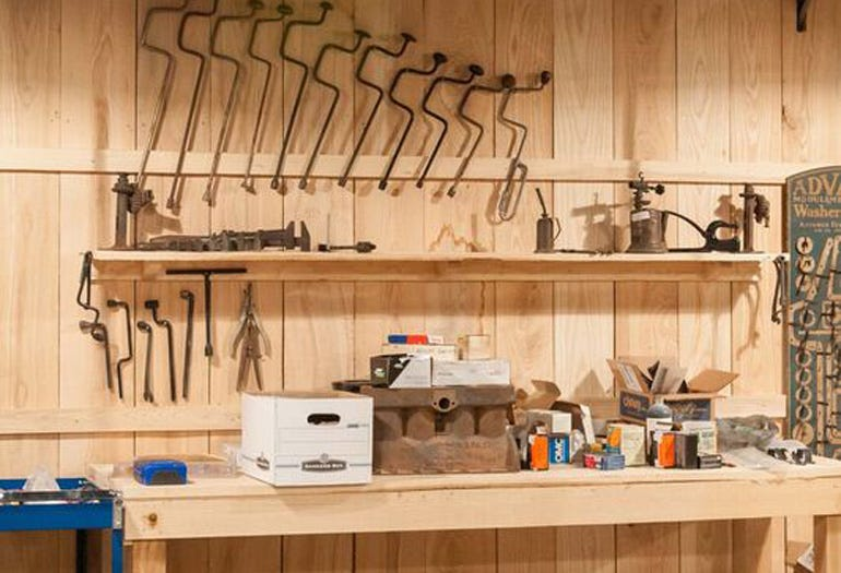 The garage walls are lined with vintage tools