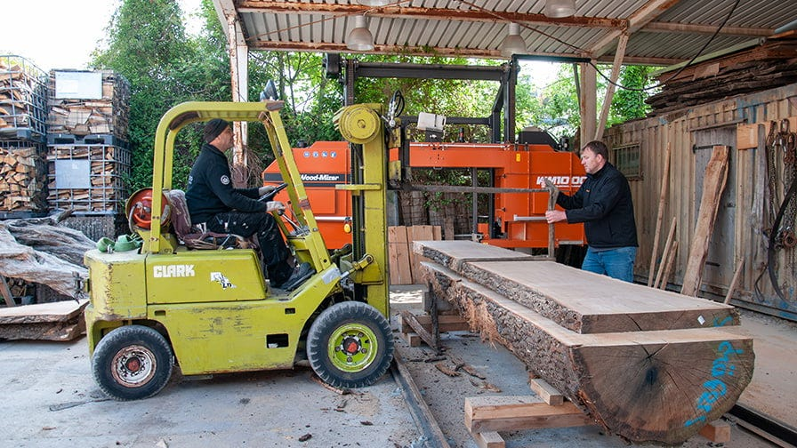 The forklift removes a heavy board